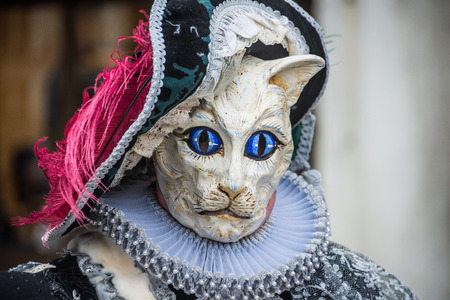 masquerade costumes: Venice, Italy - February 13, 2015: A wonderful mask participant of the annual carnival celebrations.