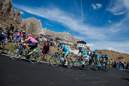 internships: Gardena, Italy May 21, 2016; Group of professional cyclists During the very hard climb of Passo Gardena in the Queen Stage of the Tour of Italy in 2016 with arrival in Corvara.