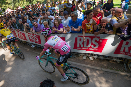 Muggioâ € ™, Italy May 26, 2016; Steven Kruijswijk in pink jersey took it towards the start of the stage, passing through the spectators.