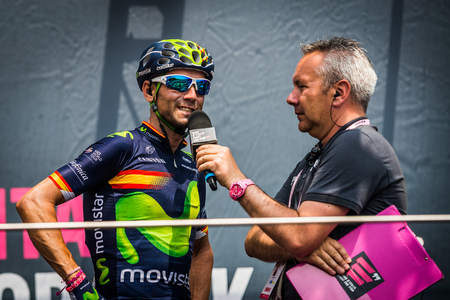 internships: Pinerolo, Italy May 27, 2016; Alejandro Valverde, Movistar Team, to the podium signatures before the start of the hard mountain stages from Pinerolo to Risoul in the Tour of Italy in 2016.