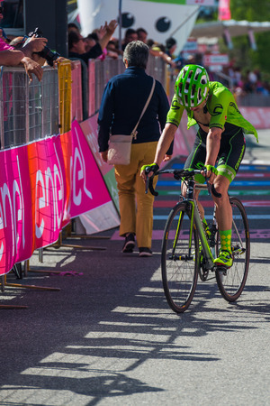 Risoul, France May 27, 2016; Professional Cyclist exhausted passes the finish line after a hard mountain stage with a uphill finish in Risoul, France.