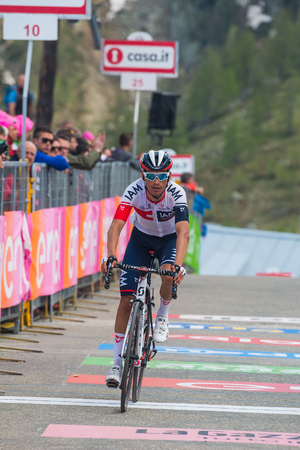 internships: Sant Anna, Italy May 28, 2016; Professional Cyclist exhausted passes the finish line after a hard mountain stage with a uphill finish in Sant Anna di Vinadio.
