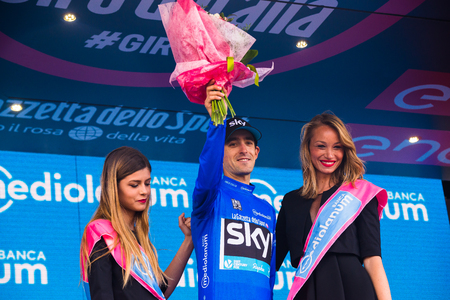 Sant Anna, Italy May 28, 2016; Mikel Nieve, Sky Team, in blue jersey on the podium after winning the classification of best climber in the Tour of Italy 2016