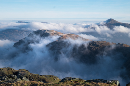 Looking above the clouds from near the summit of Beinn Ime in winter.