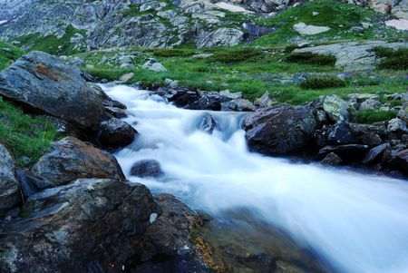 rainwear: Mountain Stream in the North Caucasus. Clean, cold streams of meltwater. Stock Photo