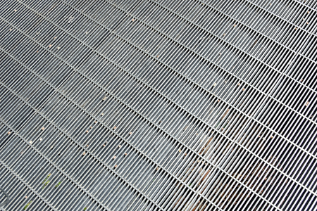 metal grate: A silver colored metal grate walkway Stock Photo