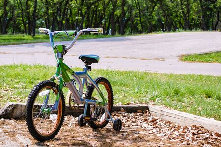 training wheels: Bicycle with Training Wheels in the Park Stock Photo