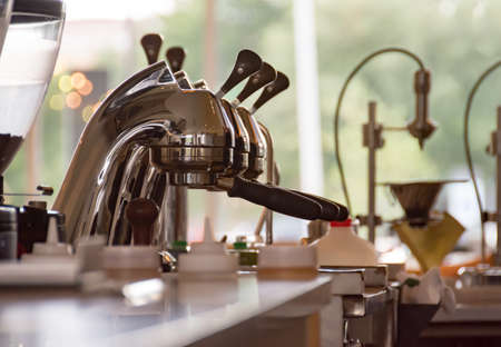 Professional Espresso Press in a Modern Coffee Shop Stock Photo