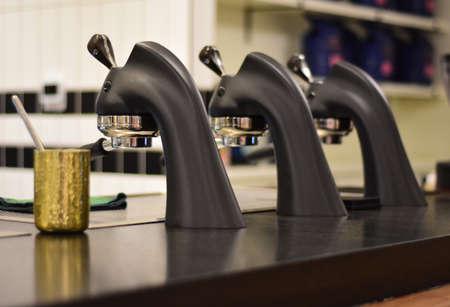 A set of professional espresso presses in a local coffee shop Foto de archivo