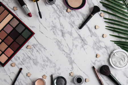 Makeup decorative cosmetic products on light marble background flat lay Banco de Imagens
