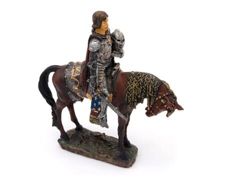 small sword: Small toy isolated knight horseman with sword