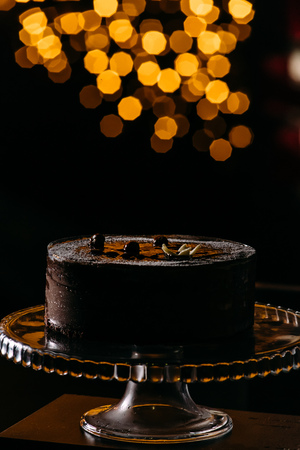 Chocolate cake on the black background