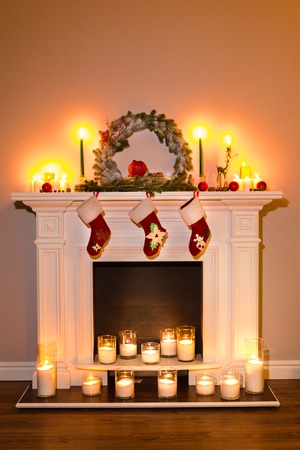 Traditional fireplace with lots of candles and christmas attributes. Room Christmas Tree Fireplace Lights