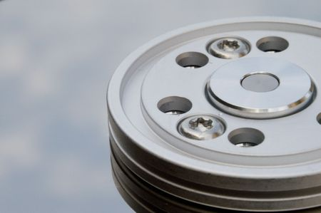 terabyte: Sky reflecting on an harddisk plate surface, detail of spindle Stock Photo