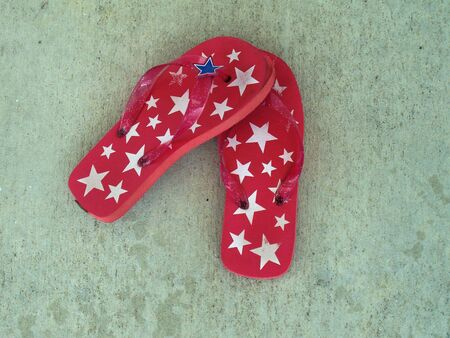 These adorable pattic flip-flops are just in time for the 4th of July! Stock Photo - 1079926