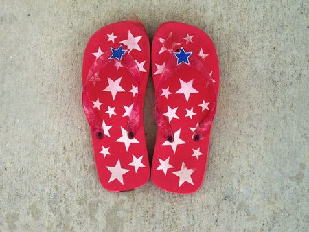 These adorable pattic flip-flops are just in time for the 4th of July! Stock Photo - 1079927