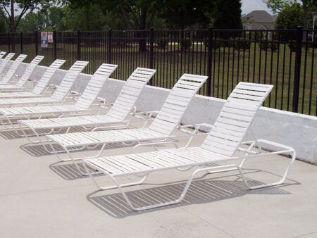 These relaxing pool chairs bring a peaceful image to mind.