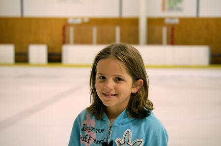 Smiling Girl Enjoying the Day at the Ice Skating Rink