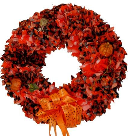 A hand made orange and black Halloween wreath
