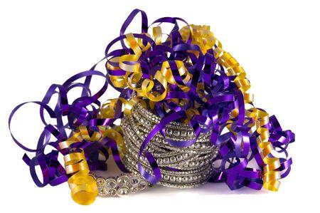Purple and gold ribbon with diamond bracelets. New Years Eve or Mardi gras celebration.