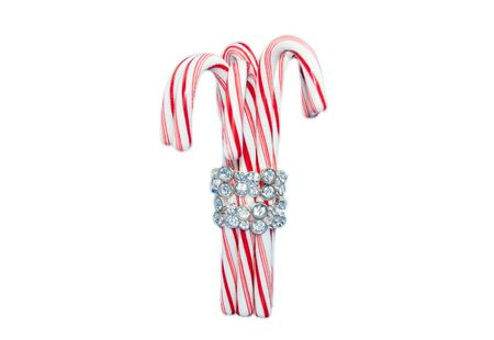 sugarplum: Christmas candy cane with diamond bracelet, Peppermint stick isolated on a white background.