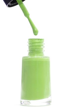 nailpolish: Green nail polish bottle isolated on white background