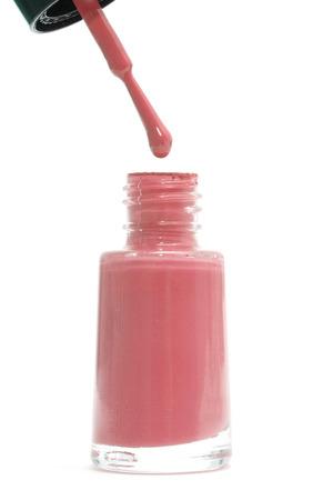 nailpolish: Red nail polish bottle isolated on white background Stock Photo