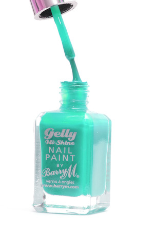 CHESHIRE, UK - February 9 2015. Blue Gelly Hi Shine Nail Polish by Barry M isolated on a white