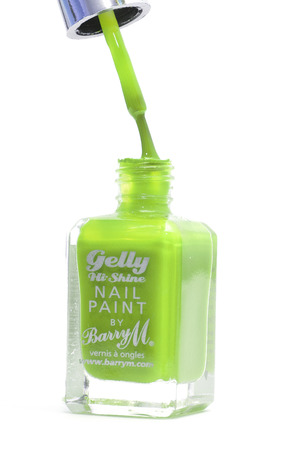 CHESHIRE, UK - February 9 2015. Green Gelly Hi Shine Nail Polish by Barry M isolated on a white