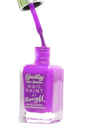 CHESHIRE, UK - February 9 2015. Purple Gelly Hi Shine Nail Polish by Barry M isolated on a white