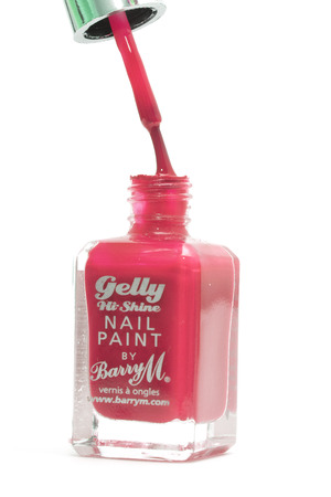 CHESHIRE, UK - February 9 2015. Red Gelly Hi Shine Nail Polish by Barry M isolated on a white