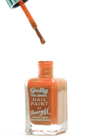 CHESHIRE, UK - February 9 2015. Orange Gelly Hi Shine Nail Polish by Barry M isolated on a white  Stock fotó - 36460812