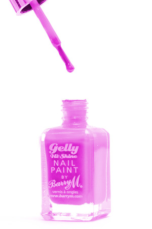 CHESHIRE, UK - February 9 2015. Pink Gelly Hi Shine Nail Polish by Barry M isolated on a white