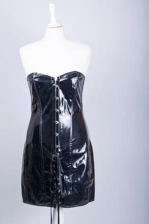 Tailors Mannequin dressed in a Black PVC Corset Dress Banque d'images