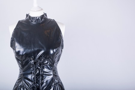 A Tailors Mannequin dressed in a Black PVC Dress