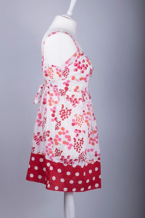 A Tailors Mannequin dressed in a Red and White Floral Polka Dot Dress