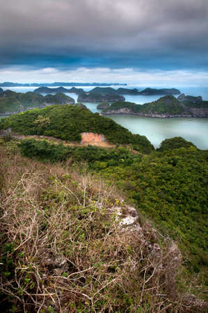 Looking out from Cat Ba Island - the largest island in Halong Bay and a major tourist draw  Stock Photo