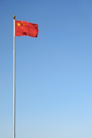 Chinese national flag on flag pole against a clear blue sky  Shot in Tiananmen Square, Beijing  写真素材