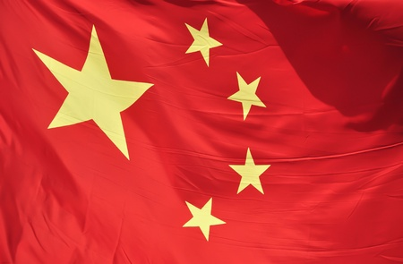 close-up of a real Chinese flag flapping in the wind photo