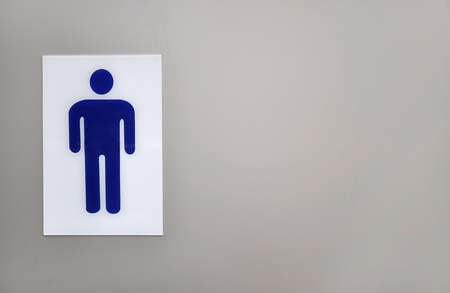 Blue gents public toilet sign on left side of grey background