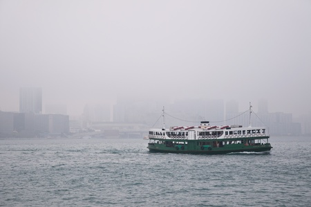 Hong Kong harbour in the mist 報道画像