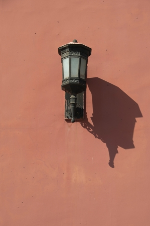 Lamp on the red walls of the Forbidden City, Beijing, China 스톡 사진