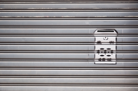 Stenciled residential mailbox on metal shutters, Hong Kong