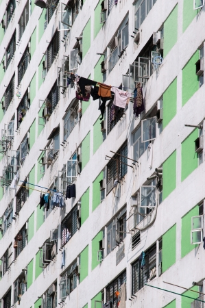 characterised: Hong Kongs public housing is characterised by high rise tower blocks located in urban estates. Here, a close-up of the Lek Yuen public housing estate in Sha Tin shows the high density living conditions familiar to many local Hong Kong residents. Stock Photo