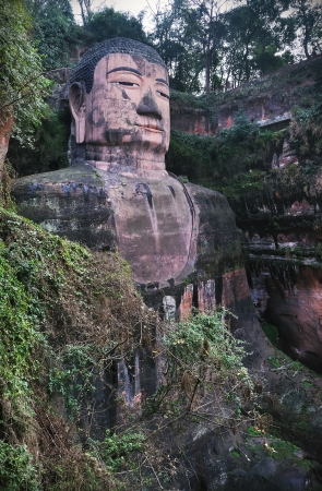 Portrait shot of the largest buddha statue in the world and a major tourist attraction in Leshan, Sichuan province, China