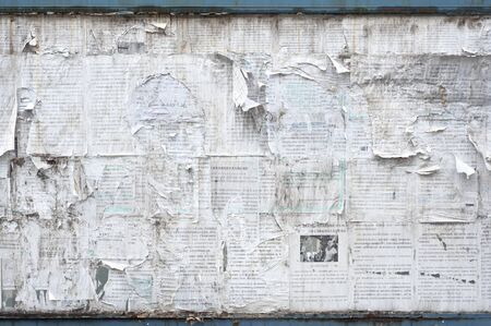 Old outdoor noticeboard with torn newspaper, China Stock Photo
