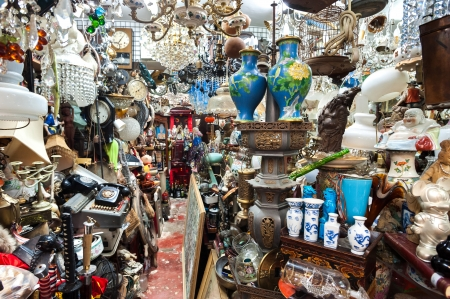 cluttered: Cluttered junk shop at Upper Lascar Row antique market, Hong Kong Stock Photo