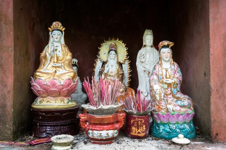Statues of Asian Buddhist goddess, Guanyin, the Goddess of Mercy 스톡 사진