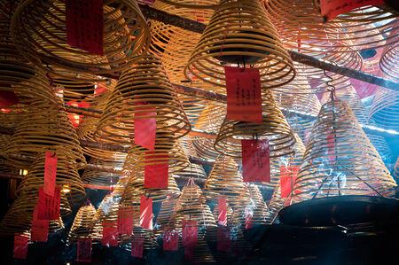 Incense coils and smoke inside Man Mo Temple, Hollywood Road, Hong Kong Editorial