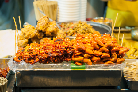 hong kong street: Grilled squid and pig intestines - typical Hong Kong street food Stock Photo